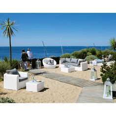 Sillón de jardín de resina trenzada blanco Mykonos | Maisons du Monde