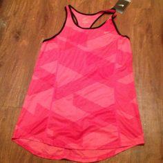 NWT Nike pink tank top Womens dri fit Nike fitness top. Black trim. Pink top with dark pink strips. . Size medium. Style 548481 . Retail : 32.00 Nike Tops Tank Tops