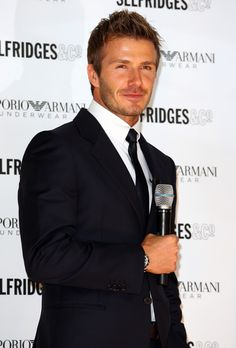 David Beckham...no one will ever come close to wearing a suit like this man