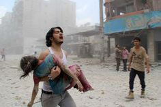 A man carries a young girl who was injured in a reported barrel-bomb attack by government forces on June 3, 2014 in Kallaseh district in the northern city of Aleppo (AFP Photo / Baraa Al-Halabi)