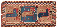 """Carriage cushion in """"Bäckahästen"""" motif double-interlocked tapestry. Skåne, Sweden, c. 1800. Three octagons with the mythological animal and stylized flowers. The central octogon is signed BbD. Lightning pattern border. Bäckahästen (The Brook Horse) was a beautiful horse that was said to emerge from brooks, lakes or ponds and attempt to lure children into riding it so it could gallop back into the water and drown them (!)."""
