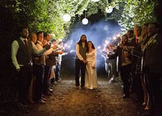 Rustic vintage wedding in the heart of Dorset. shot from a distance using off camera flash as a kicker then using the sparklers to front and side light the image.