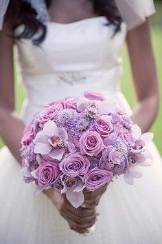 bride's bouquet -- bridesmaid's have deeper purple bouquets?
