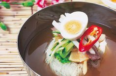 Mul-naengmyeon, Chilled Buckwheat Noodle Soup: Noodles made with buckwheat and starch. Served in a chilled beef broth with pickled radish, sliced Korean pear and a hard-boiled egg. It is often served with a side dish of vinegar and mustard.