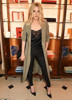 Chic in black: Mollie King attended the launch of Wendy Rowe's Eat Beautiful book at Burberry's Thomas's Café in London