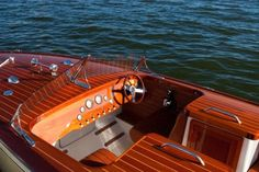 i love the old school dash on these wooden boats