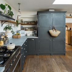 Modern Country Kitchen, Dark grey shaker kitchen cabinets with prismatic ribbed glass hanging pendant lights. Modern Country Kitchens, Grey Kitchens, Rustic Kitchen, New Kitchen, Home Kitchens, Kitchen Decor, Kitchen Country, Kitchen Modern, Distressed Kitchen
