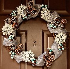 Photos of the most beautiful pinecone wreaths beautiful wreath with glittered ribbon, pinecones, berries and . Wreath Crafts, Diy Wreath, Holiday Crafts, Holiday Decor, Wreath Ideas, Snowflake Wreath, Snowflakes, Snowman Wreath, Door Wreaths