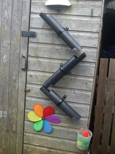 "Worms Eye-View: Fix guttering to the shed for ball or water play ("",)"