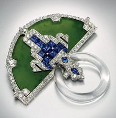 Cartier: art deco jadeite, sapphire, diamond and rock crystal brooch, circa 1923.  Christie's.
