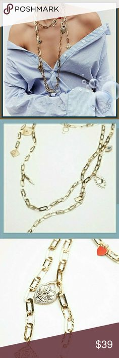 Free People Eternal Charm Scarf Metal Necklace Free People Eternal Charm Scarf Metal Necklace featuring multiple charms on an exaggerated chain link design. Lenght is approximately 16.5 inches and the extender is approximately 3.25 inches. New with tags Free People Jewelry Necklaces