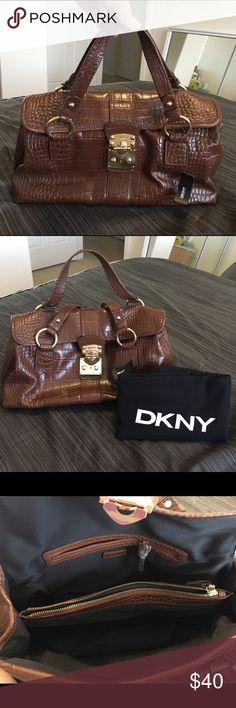 DKNY dark brown bag NWT DKNY dark brown faux croc handbag with dust bag. DKNY Bags