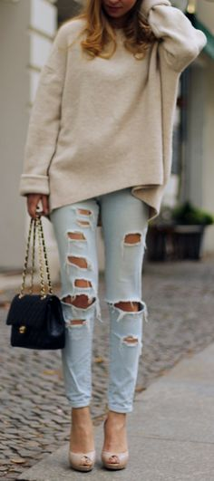 Love the sweater. No rips in the jeans though.