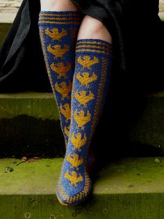 Knee high Ravenclaw House socks designed whilst participating in the Hogwarts Sock Kit Swap. The design was prompted by 'Lavender Ackerly' (a Potter-style alias) who suggested I should design some 'proper Ravenclaw socks'. The socks feature the house eagle, and a house cheer - 'Soar Ravenclaw'. I have worked to evoke the medieval origins of the Hogwarts Houses in the design of the socks.