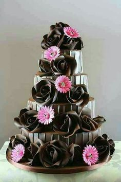 I may not know the key to world peace, but I bet chocolate has something to do with it. So today, let's go cuckoo for cocoa cakes with these gorgeous chocolate wedding designs. (By The Chocolate Rose ) OoooOOoooooo. Fancy Cakes, Cute Cakes, Pretty Cakes, Unique Cakes, Creative Cakes, Gorgeous Cakes, Amazing Cakes, It's Amazing, Chocolate Cake Designs