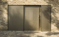 Church Walk housing scheme with triangular roof lights in Stoke Newington, London by David Mikhail and Annalie Riches. Minimal Architecture, Architecture Details, Arch Gate, Hall House, Metal Fence, Roof Light, Walking By, Exterior Doors, Windows And Doors