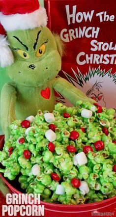 What is the Grinch's favorite food? Grinch Popcorn of course! Sweet and salty popcorn, covered in marshmallow and chock full of M&M's - this yummy Grinch Food Idea will make the heart of even the Grinchiest family member grow at least three sizes. Christmas Popcorn, Grinch Stole Christmas, Christmas Treats, Christmas Deserts, Christmas Movie Night, Christmas Fun, Christmas Parties, Christmas Activities, Holiday Fun