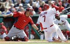 Washington Nationals catcher Kurt Suzuki, left, tags out St. Louis Cardinals' Matt Holliday trying to score on a hit by Allen Craig during the first inning of an exhibition spring training baseball game, Saturday, March 2, 2013, in Jupiter, Fla.