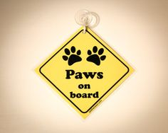 Paws on Board Car Sign with Suction Cup. For everyone who rides with their cats, dogs, hamsters, guinea pigs!... To raise awareness about animal care, it's a great idea! (Baby on board type of car accessory / decal)