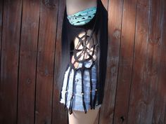 Dream catcher cut-out tank top. $10.00, via Etsy. Good idea, i'll try to make one!