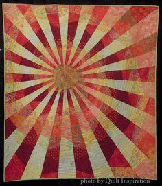 Sunburst at http://quiltinspiration.blogspot.com/2015/08/modern-quilt-month-2015-part-3.html.  Modern Quilt Month 2015 (part 3)