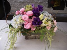 Pink, blue and purple flowers arrangement for wedding and events.