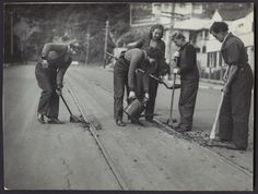 Women working for Wellington Tramways, photographed in 1943 by Charles Percy Boyer. Shows them working on the tracks. Old Pictures, Old Photos, The Hutt, Female Photographers, New Zealand, Tours, History, City, Women