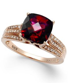 This stunning cocktail ring is sure to catch the eye with its large, cushion-cut rhodolite centerpiece (3-1/4 ct. t.w.). A frame of round-cut diamonds (1/5 ct. t.w.) complete the look. Effy's ring is