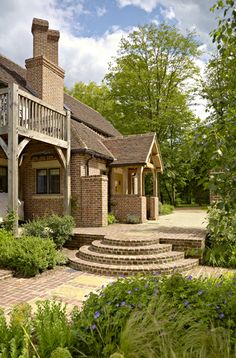 On the side of the house the porch from the kitchen and utility room opens onto the walkway up to the front of the house and down to the garden. The balcony leads out from one of the en suite bedrooms.