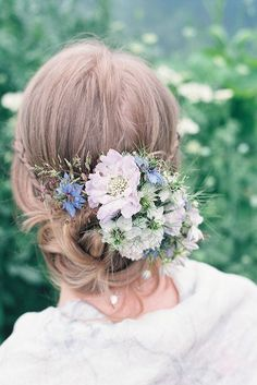 """To create this frothy flower comb featuring a palette of powdery blue, snow white, and soft lilac, The Garden Gate Flower Company used scabiosas, nigellas, brodiaeas, anemones, and trembling grasses. """"It has a gentle, old-fashioned romance to it,"""" Charlie said. """"It's a perfect example of how you can wear a lot of flowers in your hair but in a subtle way that wouldn't make you feel self-conscious."""" 
