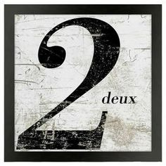 "Art print with a distressed French number motif. Made in the USA.     Product: Art print Construction Material: Wood and acid-free paperColor: Black frameFeatures: Made in the USA  Dimensions: Unframed: 9"" H x 9"" WFramed: 11"" H x 11"" W"