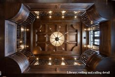 Wood Beam Ceiling of Two Story Library with Catwalk & Spiral Staircase