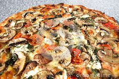 Photo about A macro closeup of a wood fired artisanal pizza full of fresh vegetable mushrooms and herbs. Image of artisanal, tomato, macro - 80575567