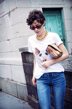 Wearing a Grover tee, Madewell skinny skinny jeans, Givenchy sandals, Etnia sunglasses, vintage Givenchy chain necklace, and Karla Deras for Roman Luxe pinky ring.