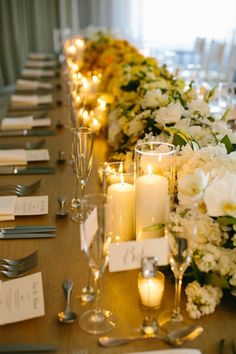 Love the brown burlap with cream candles and flowers. Use apple green napkins and clear chairs to modernize it.