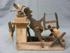 Folk Art Whirligig with Lighthouse, Seagull and Man Sawing Wood