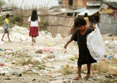 CHILD LABOR. A Filipino boy works by collecting useful materials at a slum area in Manila. File photo by Francis Malasig/EPA