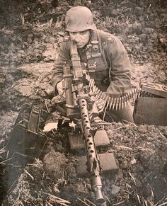 German soldier sighting a MG 34 (Maschinengewehr Modern HOAX, Photoshopped to look like an old photo. Military Weapons, Military Art, Military History, Ww2 Pictures, Military Pictures, Ww2 Photos, German Soldiers Ww2, German Army, Mg34