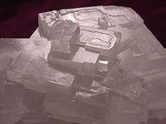 Crystal growth - An example of the cubic crystals typical of the rock-salt structure - The interface between a crystal and its vapor can be molecularly sharp at temperatures well below the melting point. An ideal crystalline surface grows by the spreading of single layers, or equivalently, by the lateral advance of the growth steps bounding the layers...