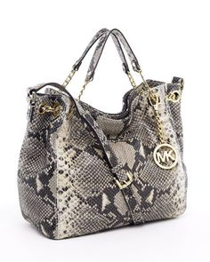 Love it I have a thing for pocketbooks lol. I want this one and the sparkly one! :)