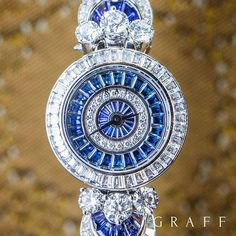 Graff's Fancy MoonLight timepiece features a flowing radial design set with rich sapphires representing the night sky, and diamonds illustrating the shadows that the moon casts over the earth. Graff Jewelry, High Jewelry, Jewellery, Women Jewelry, Trendy Watches, Watches For Men, Luxury Watches, Rolex Watches, Diamond Watches