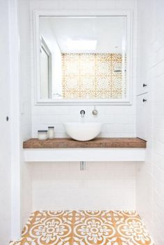 Love this small bathroom design with floating white counter topped with unfinished reclaimed wood counter top, small white basin sink, wall-mounted silver sink faucet, and gorgeous dark yellow, tan…More Minimal Bathroom, White Bathroom, Modern Bathroom, Bathroom Ideas, Tiled Bathrooms, Small Bathrooms, Master Bathroom, Bathroom Renovations, 1950s Bathroom