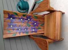 I hand painted purple clematis on this gorgeous adirondack chair my hubby made.