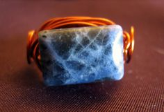 """Rugged, efrective and talking the talk.  This is a simple but very effective casual ring with a stormy blue sodalite stone mounted on magnet copper wire (which does not tarnish). 6 1/4 (US/Canadian Size) and ready to let you show a subtle stone statement - """"I'm cool, I do Handmade"""". $18.00 #sodalite #blue #copper #ring #jewellery #jewelry #hand #sodalite #wirewrapping #wire Copper Jewelry, Copper Wire, Casual Rings, Small Words, Wire Wrapped Rings, The Chic, Stone Beads, Wire Wrapping, Give It To Me"""