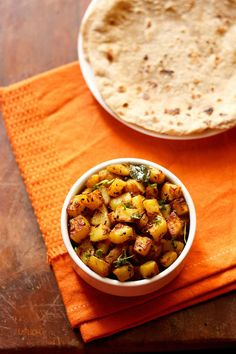 batata nu shaak recipe with step by step photos. no frills easy recipe of dry spiced potatoes made gujarati style. no onion no garlic and vegan version of batata nu shaak.