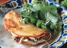 Crisp Hoi An Pancakes Recipe - Bon Appétit Once oil is hot quickly ladle 1/2 C batter into skillet. Immediately swirl pan to create thin, even layer of batter. It will bubble & begin to set almost immediately. When nearly cooked and the edge begins to curl, add shrimp, scallions, & sprouts to one half. Using spatula, fold empty half over onto filled side, pressing so it doesn't spring back.