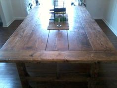 Couple of pics here of a table I made for our dining room. If needed it can seat 14 but 10 to 12 would be more comfortable.  8X4.5 feet