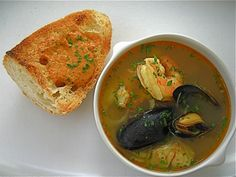 Julia Child's bouillabaisse, a classic French recipe for the Mediterranean seafood soup with tomatoes, saffron, crusty bread and rouille. Seafood Soup Recipes, Seafood Stew, Bouillabaisse Recipe, Fish And Seafood, Looks Yummy, Soup And Salad, Soups And Stews, Kids Meals, Food Porn