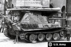 American soldiers inspecting a intact Panther Ausf G on a street in downtown Munich