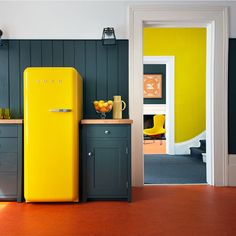 Grey and yellow kitchen with Smeg fridge